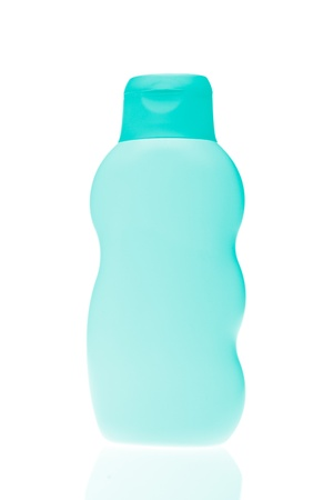 green cosmetic bottle isolated on white background photo