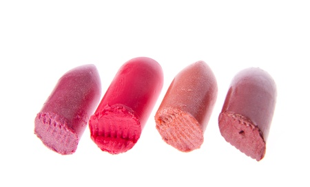 Multicoloured scraps of lipstick isolated on white background photo