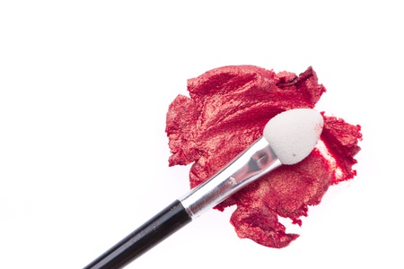 cream eyeshadow with brush isolated on white background photo