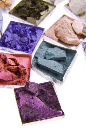 multicolored crushed eyeshadows isolated on white background photo