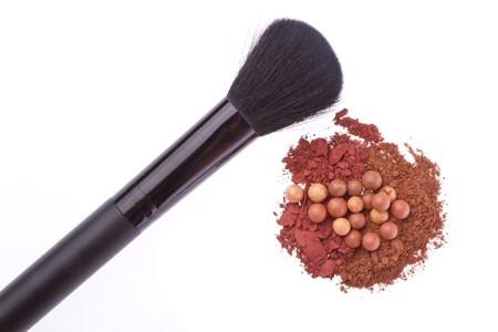 bronzing pearls and crushed eyeshadows with brush isolated on white background Stock Photo - 15804144