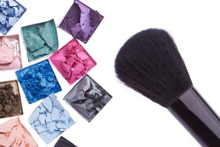 pink powder: multicolored crushed eyeshadows with brush isolated on white background Stock Photo