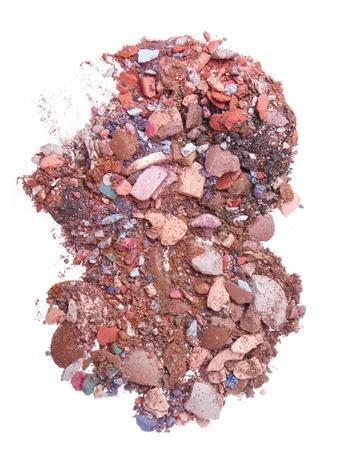 mixed crushed eyeshadows isolated on white background photo