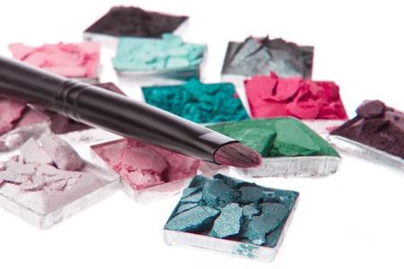 multicolored crushed eyeshadows with brush isolated on white background Stock Photo - 17677030