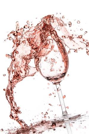 wine  pink: rose wine splashing on white background Stock Photo