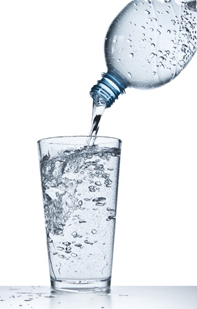 water pouring into glass on white background Stock Photo - 18178429