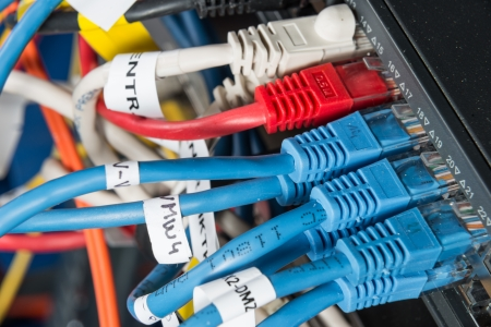 patch panel: close-up of network hub and ethernet cables Stock Photo