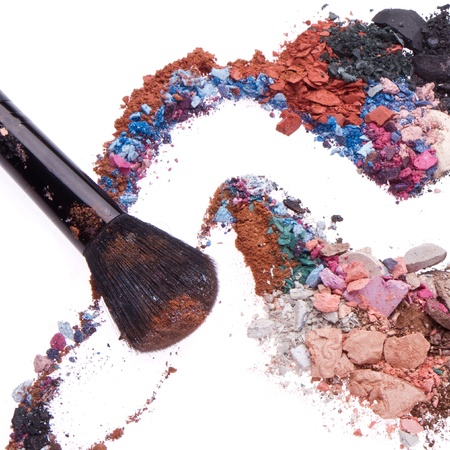 crushed eyeshadows mixed with brush isolated on white background Stock Photo