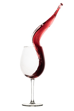 glass of red wine: red wine splashing out of a glass, isolated on white Stock Photo
