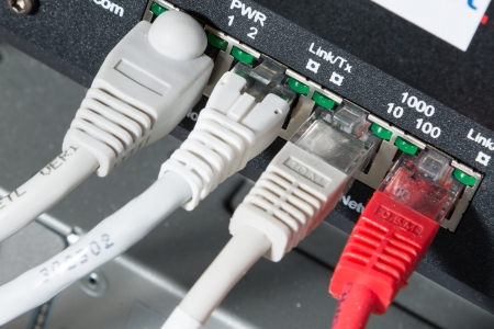 close-up of network hub and ethernet cables photo