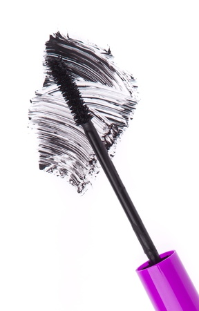 black mascara stroke isolated on white background photo