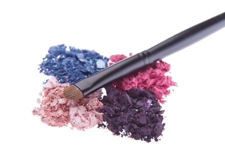 eyeshadows with brush isolated on white background photo
