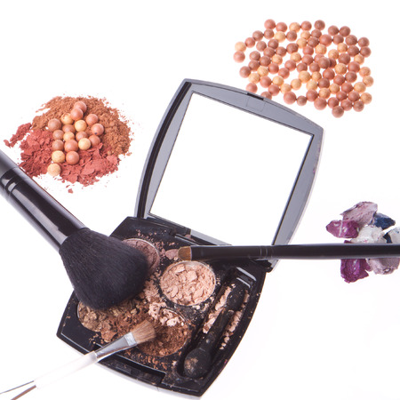 crushed compact eyeshadows with brush isolated on white background photo