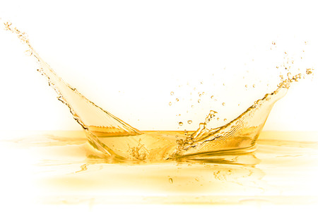 flowing: orange juice splash isolated on white background