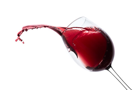 red wine splashing out of a glass, isolated on white photo