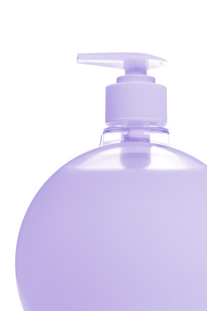 violet cosmetic bottle isolated on white background photo