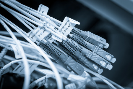 patch panel: server with fiber optic  cables in data center