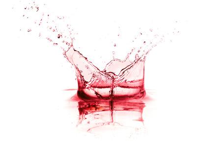 red wine splash isolated on white background photo