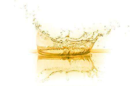 oil splash: orange juice splash isolated on white background