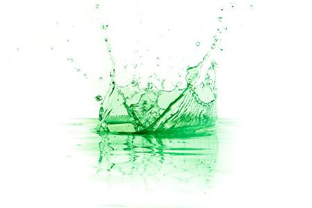green liquid splash on white background photo