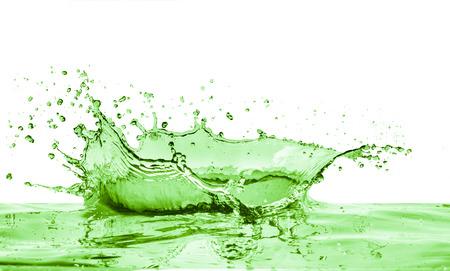 green liquid splash on white  photo