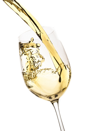 white wine splash isolated on white 写真素材