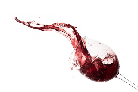 red wine splashing out of a glass, isolated on white Stock Photo