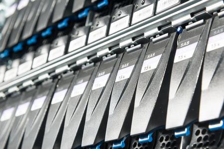 rack arrangement: close-up of hard drives in data center Stock Photo