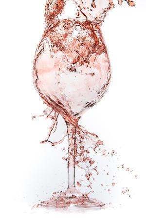 rose wine: rose wine splashing on white background Stock Photo