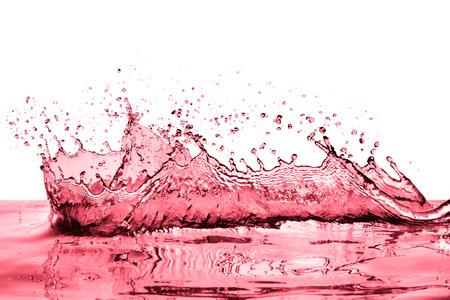 abstract liquor: splashing red wine on white background Stock Photo
