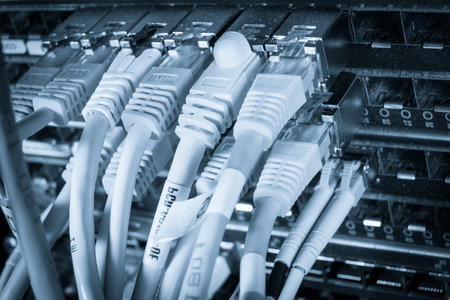 close-up of network hub and ethernet cables Stock Photo
