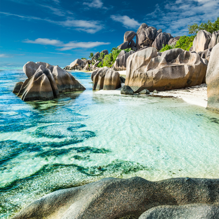 Anse Sous dArgent beach with granite boulders and turquoise sea Фото со стока
