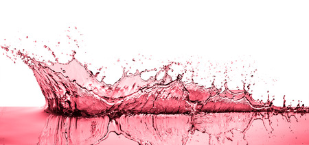 splashing red wine on white background Stok Fotoğraf