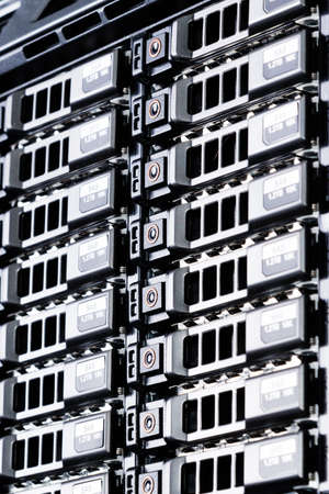 Row of hard drives serving as data storage inside server room