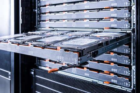 The stick out slot for the hard drive. Powerful computer equipment of the Internet provider is in the data center. Hosting site with a large database.