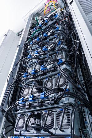 A row of racks with data storage hardware inside server room Stok Fotoğraf
