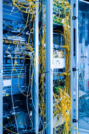 data center with servers and fiber optics cables