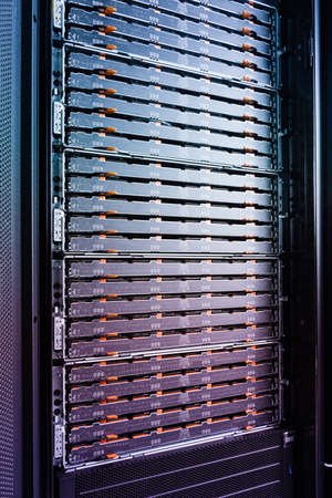 detail of data center with hard drive array inside server rack