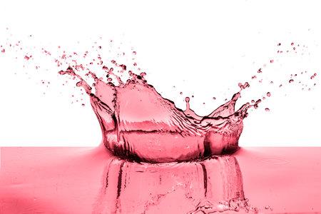 splashing red wine on white background Stok Fotoğraf