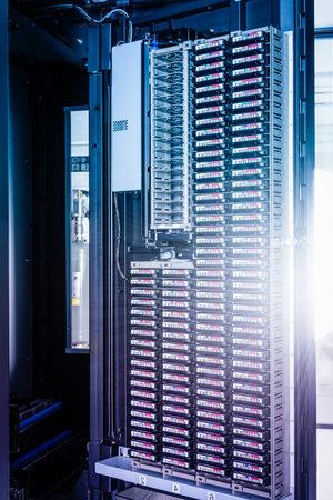 cluster of hard drives stacked inside data storage cabinet Stok Fotoğraf