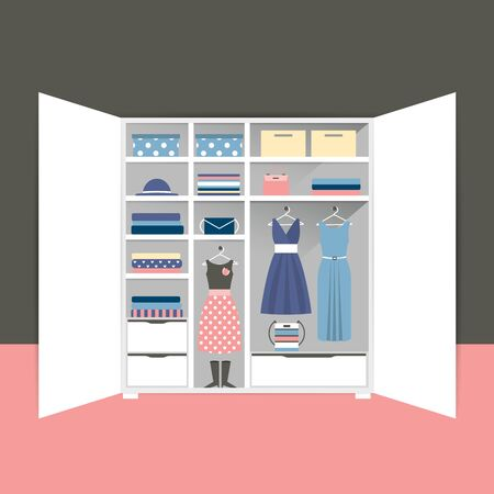 Open wardrobe with tidy clothes, shirts, sweaters, boxes and shoes. Minimalistic capsule closet.