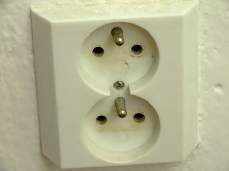 old two-part socket in the wall