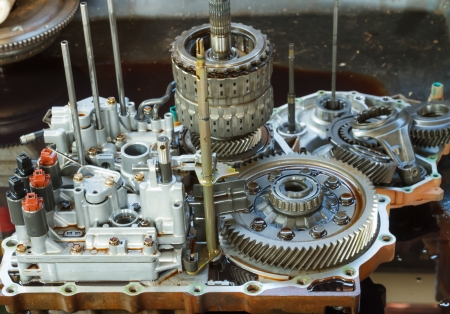 overhaul: Automobile transmission overhaul is required      when mechanical parts worn out or manufacturer recommendation  They need to be disassembled, thorough inspection of each part, measure and replace the part that shows wear or deteriorate  Stock Photo