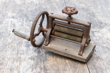 about age: Antique  squid  grinder about 100 years of age