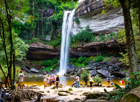 long weekend: UBONRATCHATANI  SEPTEMBER 13: Tourists  visit  Huai Luang  waterfall  In Phu Jong Na Yoi national park,  Na chaluai  district  Ubon Ratchathani  Province,  Thailand   during the long weekend  on September 13, 2015. Editorial