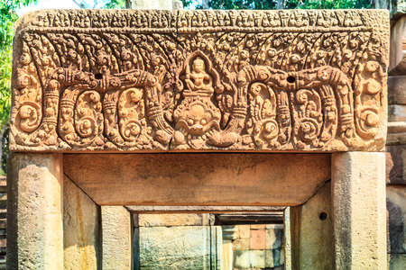 told: Stone carving  told a story of Ramayana, Emblazoned above the entrance of Meang Tum castle in, Buriram Thailand.