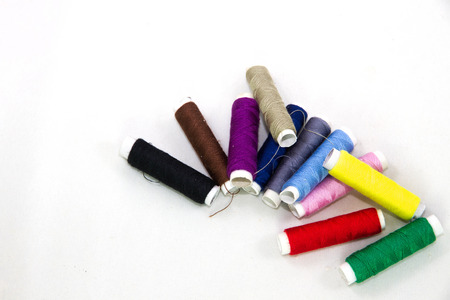 human beings: The reels of multicolored cotton which human beings used thread for stitching are very useful. Stock Photo