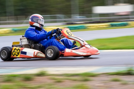 enters: Go-karts driver enters main straight on a Rotax class race
