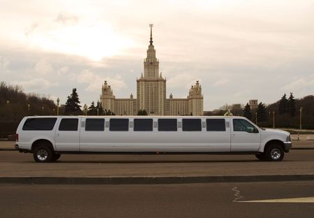 communism: A white wedding limousine in front of the Moscow State University building, a famous highrise in Moscow, Russia.