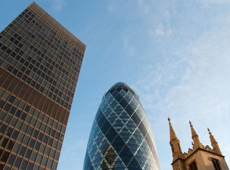 An old tower top, a typical office highrise and the modern swiss re building in London City